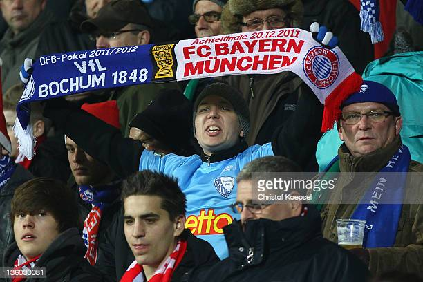 A fan of Bochum holds up a scarf during the DFB Cup round of sixteen match between VfL Bochum and FC Bayern Muenchen at Rewirpower Stadium on...