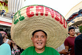 A fan of boxer Canelo Alvarez former WBC and WBA Super Welterweight World Champion wears a large sombrero hat during a news conference for the...
