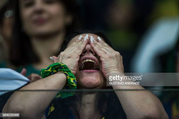 A fan of Brazil gestures during the penalty shootout of the Rio 2016 Olympic Games women's quarterfinal football match between Brazil and Australia...
