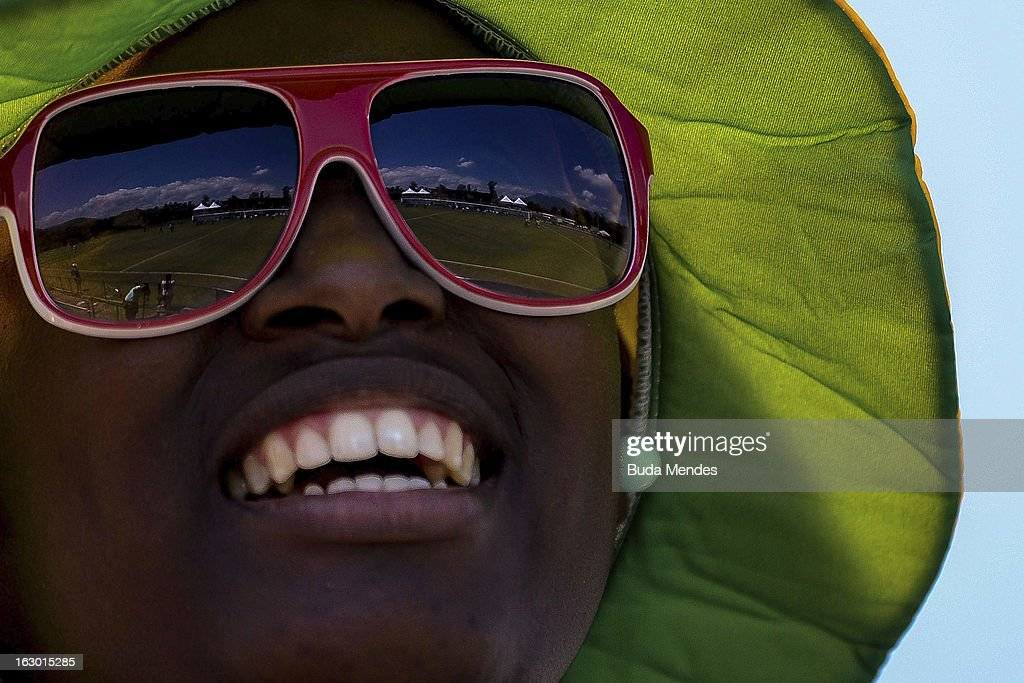 Fan of Brazil smiles during a match between Brazil and Chile as part of the Hockey World League - Round 2 at Complexo Esportivo de Deodoro on March 03, 2013 in Rio de Janeiro, Brazil.