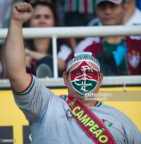 A fan of Brazilian football team Fluminense cheers before the start of the match against Cruzeiro for the Brazilian football Championship which was...