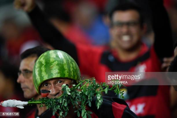 A fan of Brazil's Flamengo poses for a picture as he cheers before the Copa Sudamericana 1st leg of Semi Final soccer match with Colombia's Junior de...