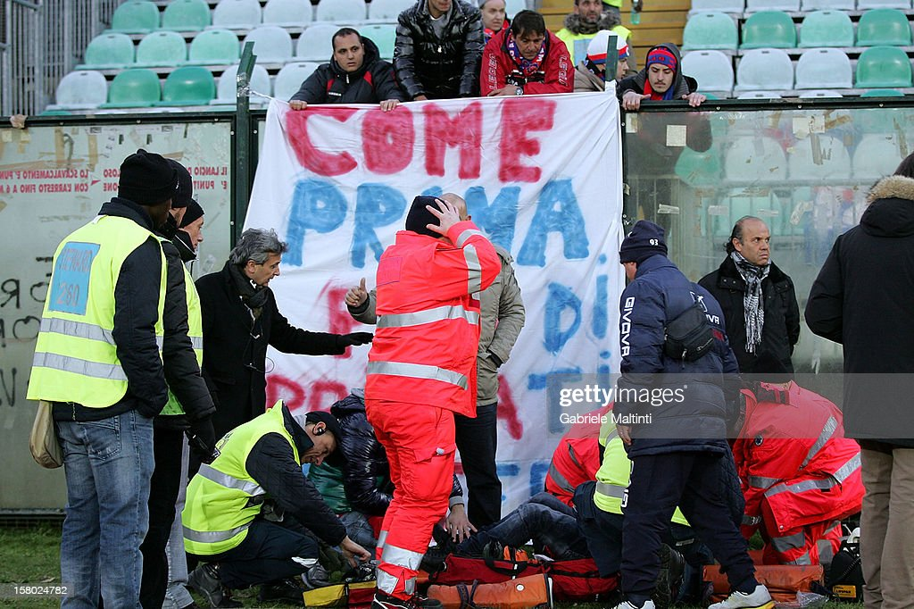 A fan of Calcio Catania is treated by medics during the Serie A match between AC Siena and Calcio Catania at Stadio Artemio Franchi on December 9, 2012 in Siena, Italy.