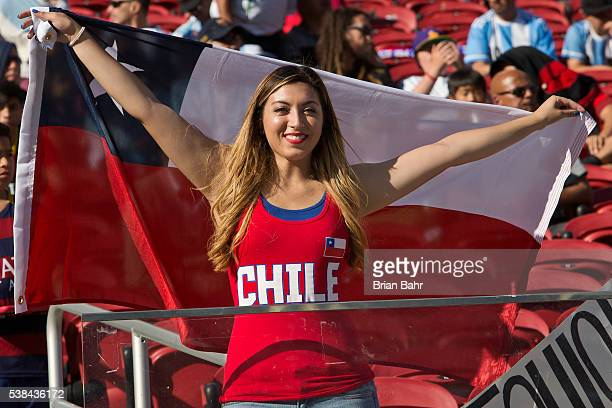 A fan of Chile cheers for her team before a group D match between Argentina and Chile at Levi's Stadium as part of Copa America Centenario US 2016 on...