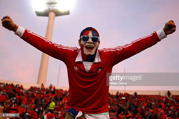 A fan of Chile cheers for his team prior the 2015 Copa America Chile quarter final match between Chile and Uruguay at Nacional Stadium on June 24...