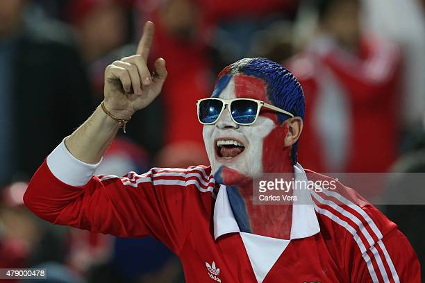 A fan of Chile cheers for his team prior to the 2015 Copa America Chile Semi Final match between Chile and Peru at Nacional Stadium on June 29 2015...