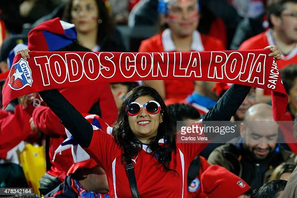 A fan of Chile enjoys the atmosphere prior the 2015 Copa America Chile quarter final match between Chile and Uruguay at Nacional Stadium on June 24...