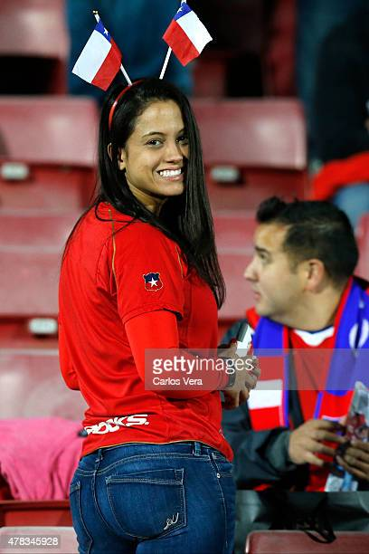 A fan of Chile smiles prior the 2015 Copa America Chile quarter final match between Chile and Uruguay at Nacional Stadium on June 24 2015 in Santiago...