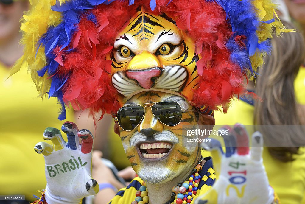 A fan of Colombia poses and smiles before a match between Colombia and Ecuador as part of the 15th round of the South American Qualifiers at Metropolitano Roberto Melendez Stadium on September 06, 2013 in Barranquilla, Colombia.