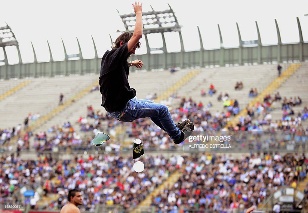 A fan of Colombian band Bomba Estereo jumps during the third day of the Vive Latino 2013 Music Fest at the Foro Sol in Mexico City, on March 17, 2013. AFP PHOTO/Alfredo Estrella