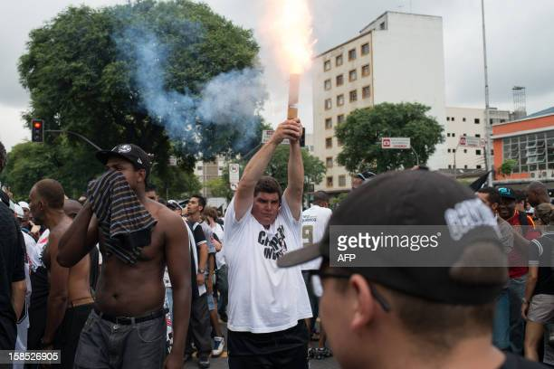 A fan of Corinthians holds a firework during their 2012 Club World Cup victory parade in Sao Paulo Brazil on December 18 2012 Copa Libertadores...