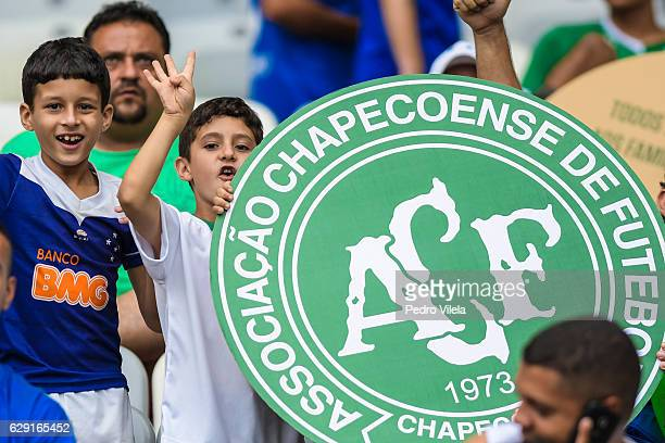 A fan of Cruzeiro pays a tribute for a Chapecoense team during a match between Cruzeiro and Corinthians as part of Brasileirao Series A 2016 at...