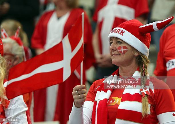 A fan of Denmark waves the national flag after the 24th Men's Handball World Championships preliminary round Group D match between Denmark and...