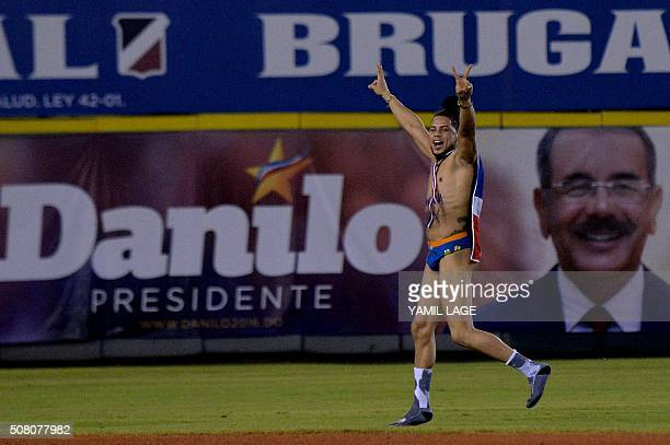 A fan of Dominican Republic team runs through the stadium during 2016 Caribbean baseball series game on February 2 2016 in Santo Domingo LAGE