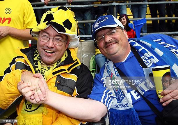 A fan of Dortmund and a fan of Schalke shake hands before the Bundesliga match between Borussia Dortmund and FC Schalke 04 at the Signal Iduna Park...