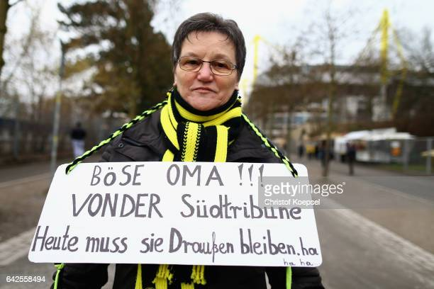 A fan of Dortmund demonstrates prior to the Bundesliga match between Borussia Dortmund and VfL Wolfsburg at Signal Iduna Park on February 18 2017 in...