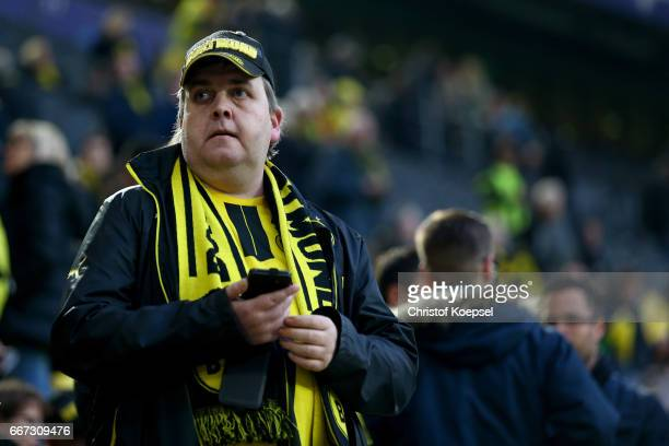 A fan of Dortmund looks concerned of the bomb attack to the bus of Borussia Dortmund prior to the UEFA Champions League Quarter Final first leg match...