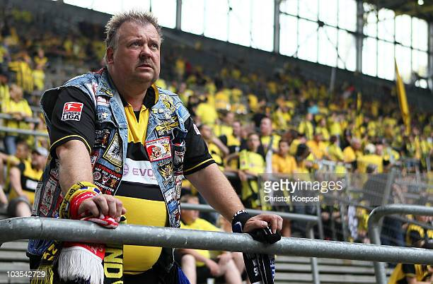 A fan of Dortmund poses with his fan jacket before the Bundesliga match between Borussia Dortmund and Bayer 04 Leverkusen at the Signal Iduna Park on...