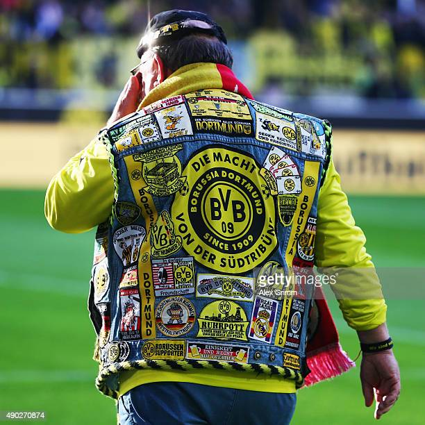 A fan of Dortmund walks along the pitch prior to the Bundesliga match between Borussia Dortmund and SV Darmstadt 98 at Signal Iduna Park on September...