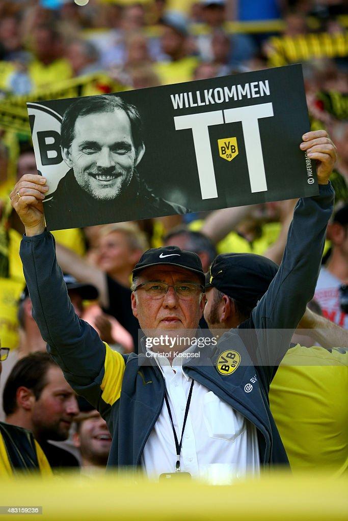 A fan of Dortmund welcomes head coach Thomas Tuchel prior to the UEFA Europa League third Qualifying round 2nd leg match between Borussia Dortmund...