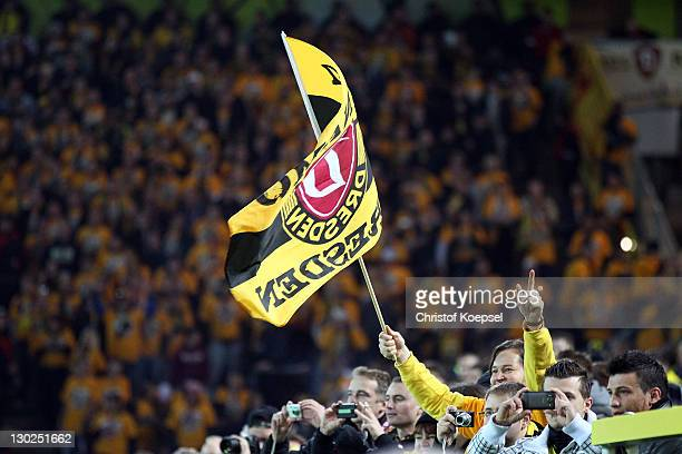 A fan of Dresden shows a banner during the second round DFB Cup match between Borussia Dortmund and Dynamo Dresden at SignalIduna Park on October 25...