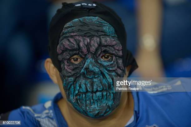 A fan of Emelec cheers his team during a first leg match between Emelec and San Lorenzo as part of round of 16 of Copa CONMEBOL Libertadores...