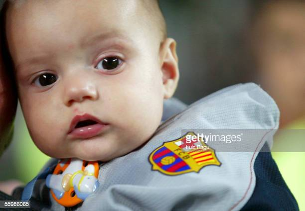 A fan of FC Barcelona brings their baby to the match between FC Barcelona and Osasuna of the Spanish Primera Liga on October 22 2005 at the Camp Nou...