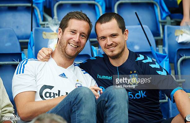 A fan of FC Copenhagen speaks to a fan of Brondby IF prior to the Danish Alka Superliga match between Brondby IF and FC Copenhagen at Brondby Stadion...