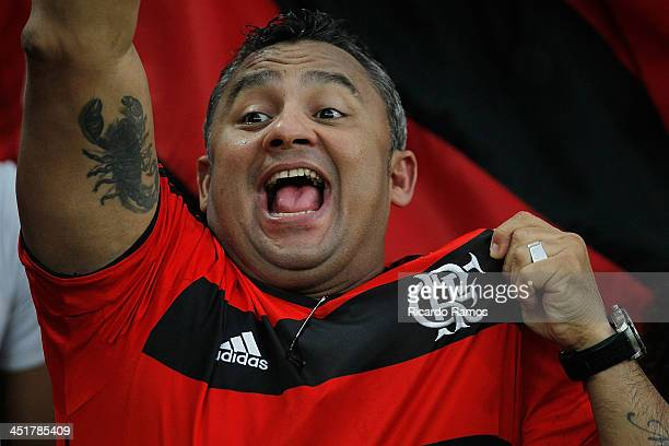 A fan of Flamengo celebrates during the match between Flamengo and Corinthians for the Brazilian Series A 2013 at Maracana on November 24 2013 in Rio...