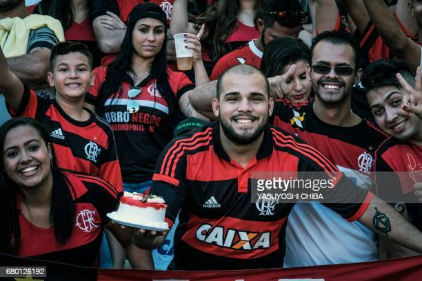 A fan of Flamengo celebrates his birthday with a cake before their Copa Carioca final football match against Fluminense at Maracana stadium in Rio de...