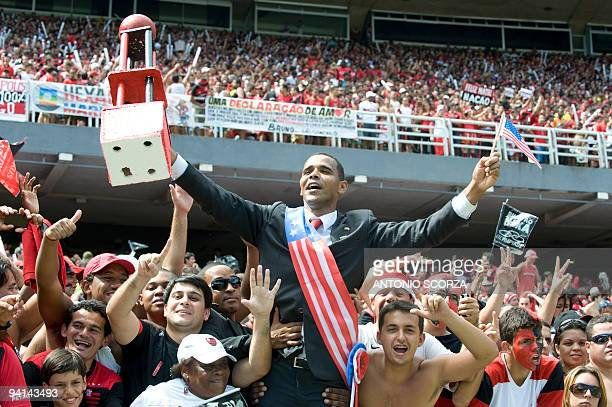 A fan of Flamengo fancy dressed as US President Barack Obama cheers his team before the start of the Brazilian Championship final date match against...