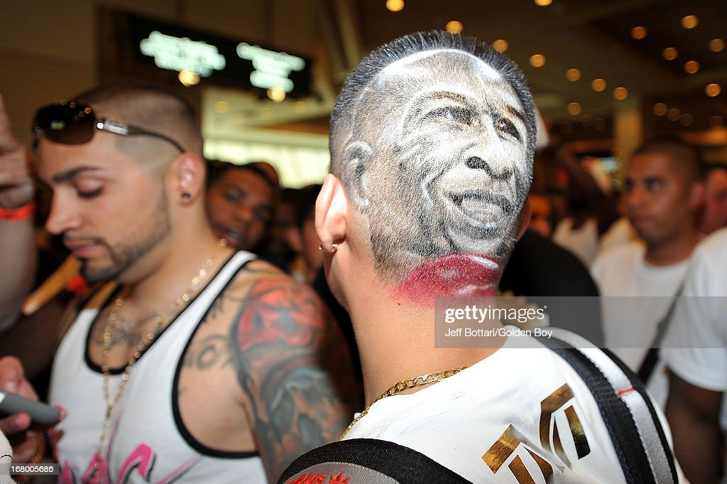 A fan of Floyd Mayweather Jr. shows off his head painting while waiting to enter the official weigh-in for boxers Floyd Mayweather Jr. and Robert Guerrero for their welterweight bout at the MGM Grand Garden Arena on May 3, 2013 in Las Vegas, Nevada. Mayweather will defend his WBC welterweight title against Guerrero.