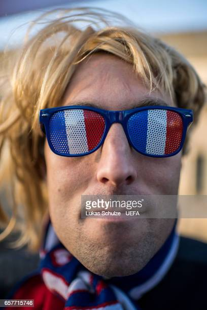A fan of France wears glasses with the colors of his country prior to the FIFA 2018 World Cup Qualifier between Luxembourg and France at Stade Josy...