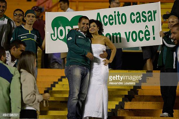 Fan of Goias dressed as a bride with her boyfriend before a matchÊbetween Goias and Vitoria as part of Brasileirao Series A 2014 at Estadio Serra...