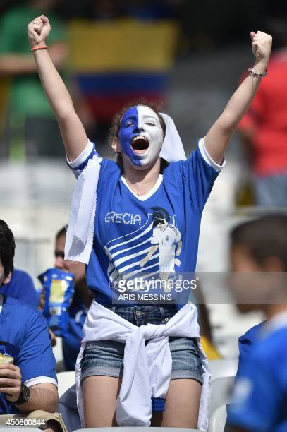 A fan of Greece cheers before a Group C football match between Colombia and Greece at the Mineirao Arena in Belo Horizonte during the 2014 FIFA World...