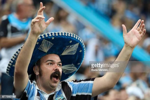 A fan of Gremio vibrates before the first leg match between Gremio and Lanus as part of Copa Bridgestone Libertadores 2017 Final at Arena do Gremio...
