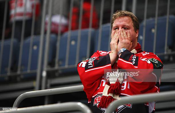 A fan of Haie looks dejected after the end of the Deutsche Eishockey Liga game between Koelner Haie and Hannover Scorpions at Lanxess Arena on...