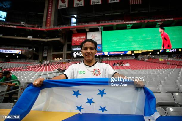 A fan of Honduras holds a flag during the CONCACAF Gold Cup 2017 quarterfinal match between Mexico and Honduras at University of Phoenix Stadium on...