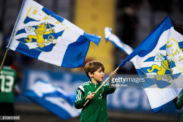 Fan of IFK Goteborg hold the flag before the Allsvenskan match between IFK Goteborg and GIF Sundvall at Gamla Ullevi on November 5 2017 in Gothenburg...
