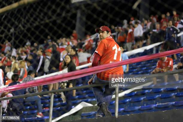 A fan of Independiente looks on during a first leg match between Libertad and Independiente as part of the semifinals of Copa CONMEBOL Sudamericana...