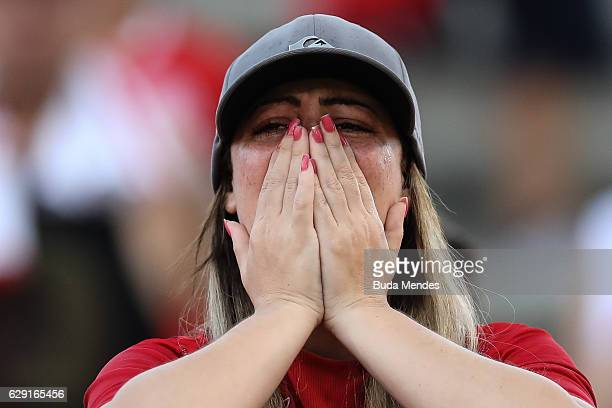 A fan of Internacional cries during a match between Fluminense and Internacional as part of Brasileirao Series A 2016 at Giulite Coutinho Stadium on...