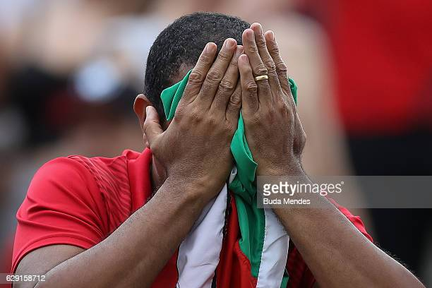 A fan of Internacional reacts during a match between Fluminense and Internacional as part of Brasileirao Series A 2016 at Giulite Coutinho Stadium on...