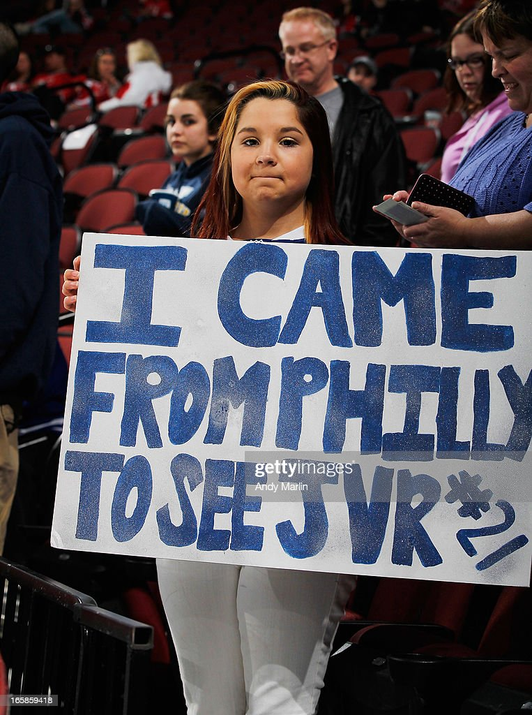 A fan of James van Riemsdyk #21 of the Toronto Maple Leafs holds a sign during pregame warmups prior to the game against the New Jersey Devils at the Prudential Center on April 6, 2013 in Newark, New Jersey.