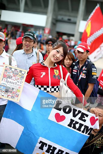 A fan of Kimi Raikkonen of Finland and Ferrari poses outside the circuit before the Formula One Grand Prix of Japan at Suzuka Circuit on September 27...