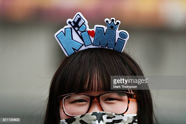 A fan of Kimi Raikkonen of Finland and Ferrari with a Kimi head band during previews to the Formula One Grand Prix of China at Shanghai International...
