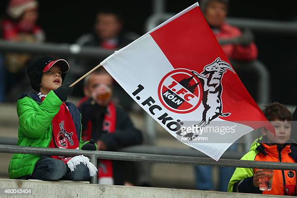 A fan of Koeln waves his flag prior to the Bundesliga match between 1 FC Koeln and FC Augsburg at RheinEnergieStadion on December 6 2014 in Cologne...