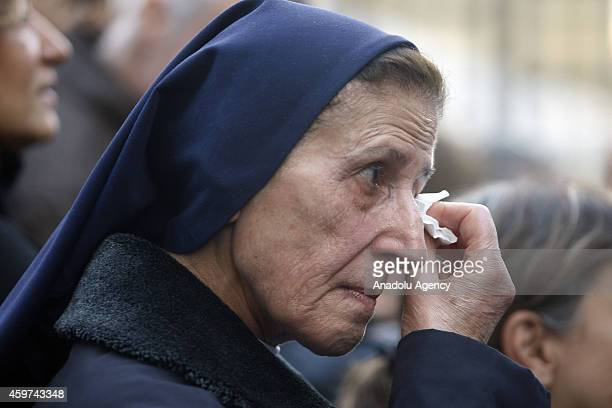 A fan of Lebanese singer Sabah whose real name was Jeanette Gergis AlFeghali cries during the funeral ceremony held at Saint George Church in Beirut...