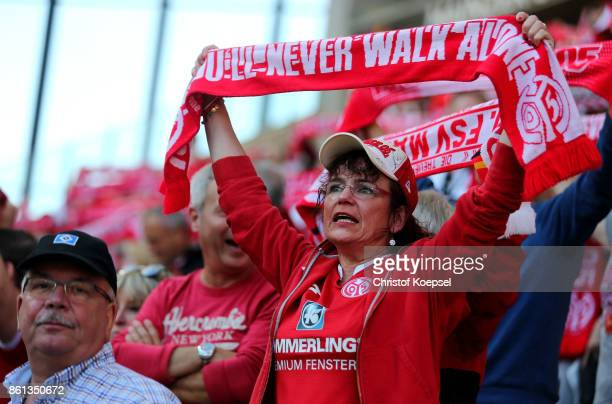 A fan of Mainz celebrates during the Bundesliga match between 1 FSV Mainz 05 and Hamburger SV at Opel Arena on October 14 2017 in Mainz Germany
