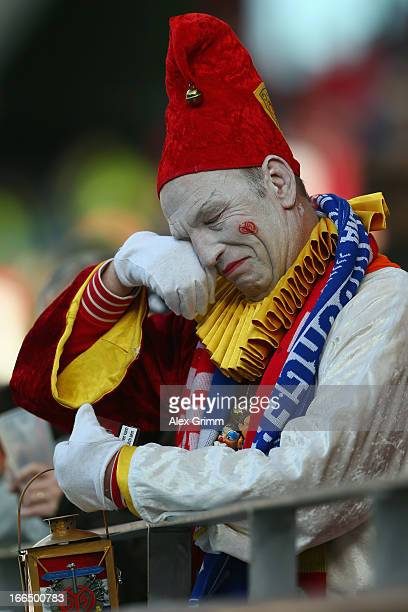 A fan of Mainz reacts after the Bundesliga match between 1 FSV Mainz 05 and Hamburger SV at Coface Arena on April 13 2013 in Mainz Germany