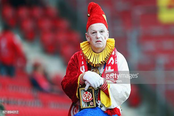 A fan of Mainz reacts after the Bundesliga match between 1 FSV Mainz 05 and 1 FC Koeln at Coface Arena on April 17 2016 in Mainz Germany